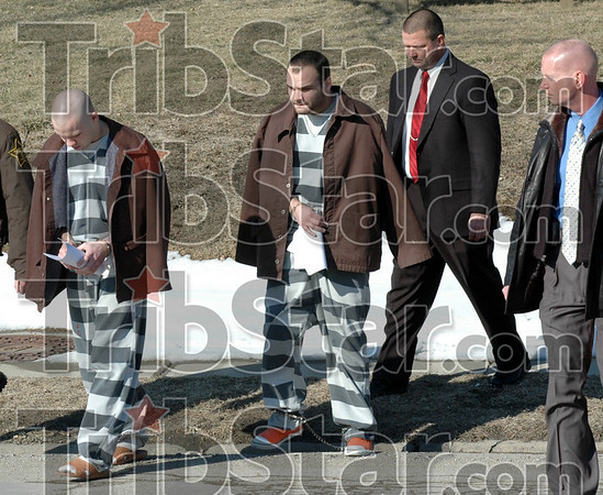 Charged: Cousins James Levi Orman and Joshua Orman are led from the Clay County Courthouse Wednesday afternoon after being read new charges in their home invasion case. The two are being escorted by Indiana State Police detectives Sam Stearley and Chris Carter.