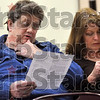 Tribune-Star/Joseph C. Garza<br /> Facts and figures: Gary Moody and JoAnn Hyde pour over a Vigo County Public Library Budget Shortfall Facts sheet before the start of the public meeting Wednesday at the main library branch.