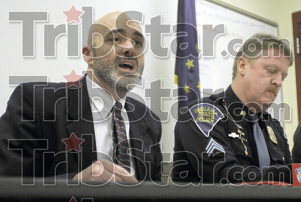 Prosecutor: Clay Co. prosecutor Lee Reberger speaks at a press conference announcing new charges against men accused of home invasion Wednesday afternoon. At right is Indiana State Police public information officer Sgt. Joe Watts.