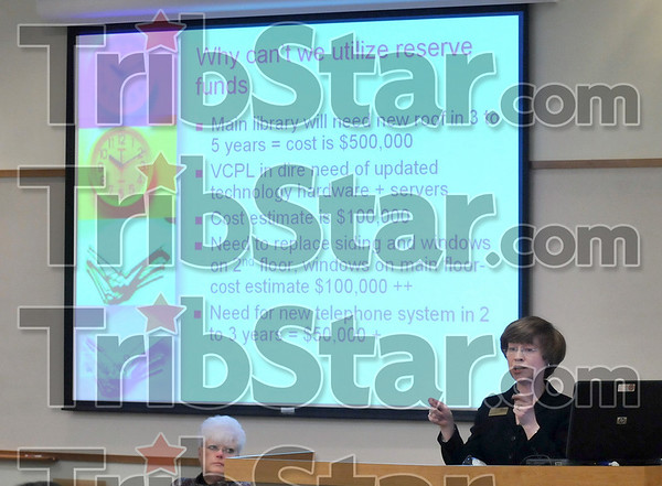Tribune-Star/Joseph C. Garza<br /> The reasons not to: Vigo County Public Library Director Nancy Dowell explains reasons why the library can't use its reserve fund during a public meeting Wednesday at the library.