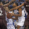 Tribune-Star/Joseph C. Garza<br /> Out of reach: Indiana State's Harry Marshall snatches a rebound out of the reach of Southern Illinois's Anthony Booker and Kevin Dillard during the Sycamores' game against the Salukis Wednesday at Hulman Center.