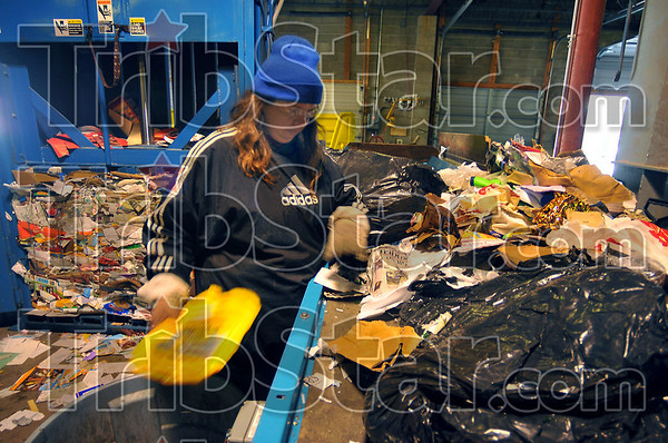 Sorting it all out: Belinda Clark is an 11 year employee of Goodwill. Here she sorts through household recycling, brought in over the Christmas holidays when they were the only free recycling center that was open.