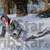 Tribune-Star/Joseph C. Garza<br /> Take that: Leah Parker is pushed into a snow bank by her brother-in-law, Seth Hon, after Parker threw a huge piece of snow from the snow bank at him Wednesday at Fairbanks Park.