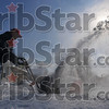 Tribune-Star/Joseph C. Garza<br /> Blowin' snow: Don Albert fills the air with powdery snow as he blows it off the sidewalk in front of his house on north 35th Street Wednesday.