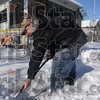 Tribune-Star/Joseph C. Garza<br /> The postman digs it: Thirteen and 1/2 Street resident Jessie Welty clears a path in front of his home as postal carrier Gary McGaha uses the cleared path to drop off mail at Welty's home Wednesday.
