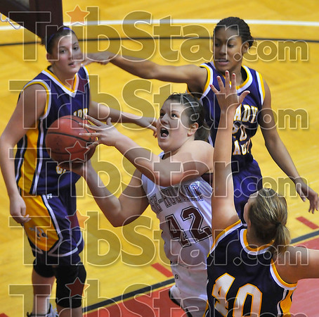 Heavy traffic: Rose-Hulman's Shayna Banet splits the Yellowjacket defense in second half action Wednesday night. Defending for Defiance are Amber Bailey, Shavonda Price(20) and Holly Stein(40).