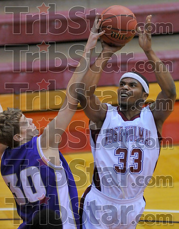 Tough times: Engineer Lorenzo Rice looks for two points from the paint against Defiance forward Tietje.