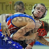 Struggle: Terre Haute North's Jedd Page strains to get Owen Valley wrestler Michel Bird onto his back in their 119 pound match.