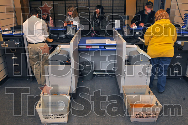 At your service: Customers wait their turn at the counter of the newly opened Contract Postal Unit in the old Post Office building at 7th and Cherry Streets.