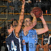 Inside: SMWC forward Adrianne Blickenstaff tries for a basket around the defense of St. Ambroses' Mary Burmeister.
