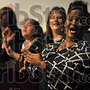 Tribune-Star/Joseph C. Garza<br /> Song of praise: Razja Friend of the Terre Haute Gospel Community Choir sings along with her fellow choir members during the Martin Luther King, Jr. Day of Celebration Monday at Ivy Tech Community College.