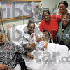 Tribune-Star/Joseph C. Garza<br /> Five generations: Sherlyn Towles, center, holds her new son, Noah Daeshawn Alan Pope, as she poses for a photo with her great-grandmother, Mary Hutchinson, mother, Tammy Towles, mother-in-law, Phyllis King and grandmother, Sheryl Davis, Monday at Union Hospital. Noah was born Monday at the hospital.