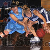 Scramble: Pomeroy Rebecca Tracy fights for control of the ball with St. Ambroses' Jenny Clark.