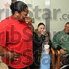 Tribune-Star/Joseph C. Garza<br /> Tears of happiness: Tammy Towles chokes back tears after she announced to her family that her daughter, Sherlyn Towles, had a baby boy Monday at Union Hospital. Celebrating with Towles are Fallon Jones and Sheryl Davis.