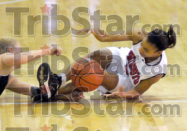 Loose ball scramble: North's #3, Ashley Burkins goes to the floor for a loose ball Monday night.