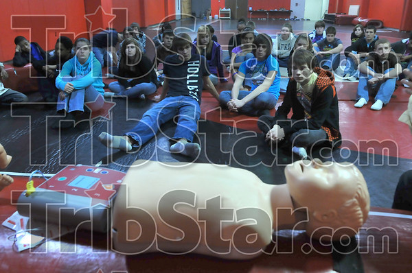 Practice makes perfect: Terre Haute South Vigo Higth School freshmen listen to instruction on the proper method of giving CPR. Personnel from Regional Hospital provided the instruction.