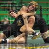 152: Viking wrestler John Burt tries for an advantage over Terre Haute South's Eric Joyal in their 152 pound match Monday night.