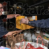 For the hungry: Terre Haute Fire Department Lt. Fred Hamblen helps load a box of food with firefighter Don Seprodi Tuesday at Fire Station No. 7 at 13th Street and Ft. Harrison Road. Seprodi lead an effort to collect about 1,000 pounds of food for St. Patrick's soup kitchen.