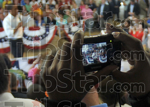 Tribune-Star file photo/Joseph C. Garza<br /> For the scrapbook: A member of the audience take a photo of then-democratic presidential candidate Barack Obama as he talks Saturday, Sept. 6, 2008 at the Wabash Valley Fairgrounds.