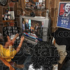 Tribune-Star/Joseph C. Garza<br /> Recording history: DaNia Bailey and Johonna Brown take photos with their cellular phones of President Barack Obama signing nomination papers on television Tuesday at Margaret Taylor's home on south 14th Street.