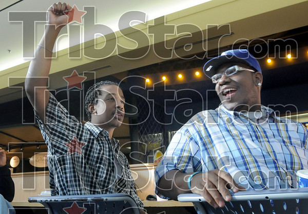 Celebration: Indiana State University students Nicholas Williams and Jamel Carter celebrate after the swearing-in ceremony of Barack Obama Tuesday afternoon in the student union food court.