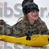 Tribune-Star/Joseph C. Garza<br /> Kaeyla Griffy, 5, licks off a few snowflakes as she zips down the sledding hill at Deming Park Tuesday.