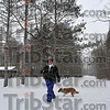 "Quiet stroll: SHirley Martin and ""Sissy"" took an afternoon walk throught he woods at Dobb's Park. She said the snow made the walking more difficult but not bad."