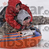 Tribune-Star/Joseph C. Garza<br /> Skyler Burris, 5, laughs with excitement as he sleds down a hill on his dad Aaron's back Tuesday at Deming Park.