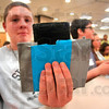 "Tribune-Star/Joseph C. Garza<br /> With some help from sister, Lexi March, Matt March, 13, shows off his ""wallet holder"" (which was rumored to have started out as a duct tape wallet) during the Vigo County Public Library's Express Yourself! program Thursday at the library."