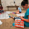 Tribune-Star/Joseph C. Garza<br /> Who says you can't accessorize in this economy? Obviously, not Bailee Williams, 13, as she makes a purse out of orange and gray duct tape Thursday at the Vigo County Library.