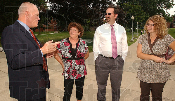 Making the rounds: Interim Rose-Hulman president Matt Branam talks with  some of the school's business office workers. From the left they are: Loretta Ormsby, Dave Hahn and Julie Paul.