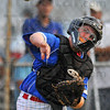 In time: North Terre Haute catcher T.J. Collett throws to first for an out.