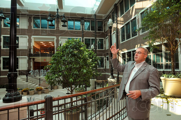 Bradley Balch, dean of the Indiana State University College of Education, discusses the attributes of the school's atrium during a tour of the building Thursday on the Indiana State campus.