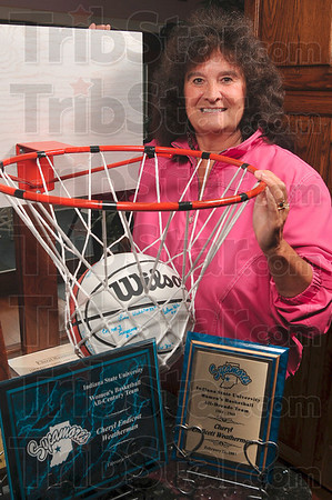 "Tribune-Star/Joseph C. Garza<br /> From the backyard to the Hall of Fame: ""It all began with one shot,"" said Cheryl Weatherman about her career that started with the purchase of a basketball hoop she made with her sister and the first shot she took with that goal that she poses with here at her home Wednesday in Fairview Park."