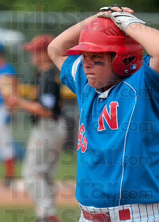 Tribune-Star/Joseph C. Garza<br /> The waiting game: Terre Haute North's Chase Jones waits on first base as officials let a new McCutcheon batter warm up on the mound during the 11-12-year-olds semifinal Thursday at the Terre Haute North Little League Ballpark.