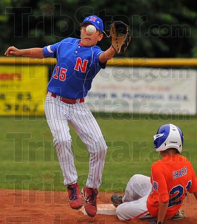 Off target: Greg Hannum gloves a throw while Bartholomew County baserunner Nick Sharp slides safely into second base.
