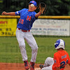 Off target: Greg Hannum gloves a throw while Bartholomew County baserunner Nick Sharp slides safely into second base.