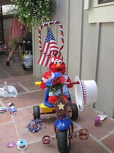 Mia and Elmo Getting Ready for 4th of July Bike Parade