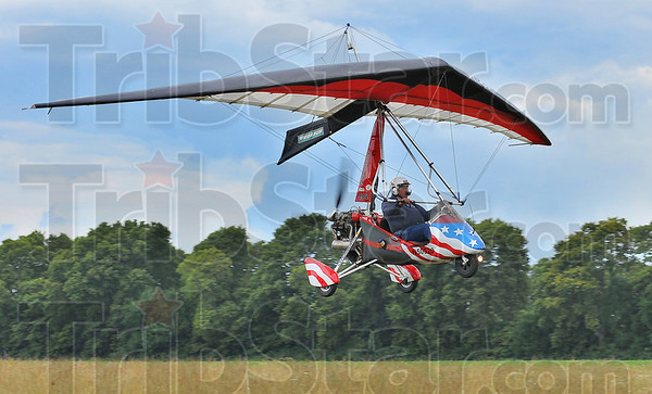 Winged Steed: Bob Bedwell flies his Pegasus Trike light sport aircraft over Terry Brentlingers' airstrip Sunday afternoon.