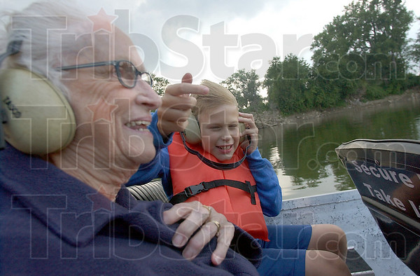 Fun ride: Wandell Gabey and her grandson Scotty Thompson start their trip down the Wabash River with Dennis Hoopingarner on the airboat Independence.