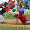 Too late: Riley pitcherNathan Biggs can't stop Ian Fonceca from scoring for Linton in their Cal Ripken tournament game.