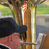 Time to reflect: Allen Keathley warms up with his tuba just before the Terre HAute Community Band performed Sunday evening at Fairbanks Park.