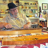 Strummin' along: Ray Wolverton, formerly of Chicago, makes and sells dulcimers at Billie Creek Village.