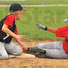 Safe: Riley's Kyle Jackson tags Linton baserunner Ian Fonceca too late at second base in their Cal Ripken 11 year-old baseball game Sunday afternoon in Riley.