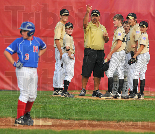 Looking for help: Clinton manager Tom Waldrop calls for a new pitcher in the first inning of their game against Terre Haute North Thursday evening.