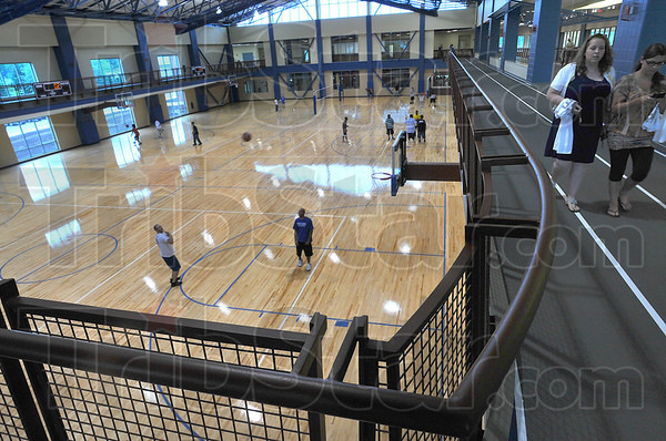 Run with us: The open gym of the new ISU student recreation Center boasts six basketball goals and an elevated track for indoor walking and running.