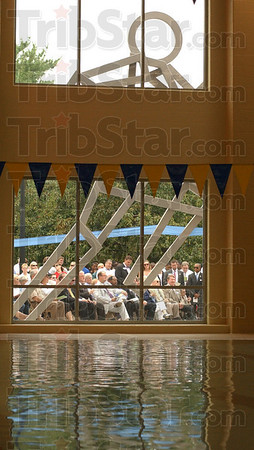 Reflecting on the future: The attending crowd is seen through the pool windows of Indiana State Universities new Student Recreation building Friday afternoon.