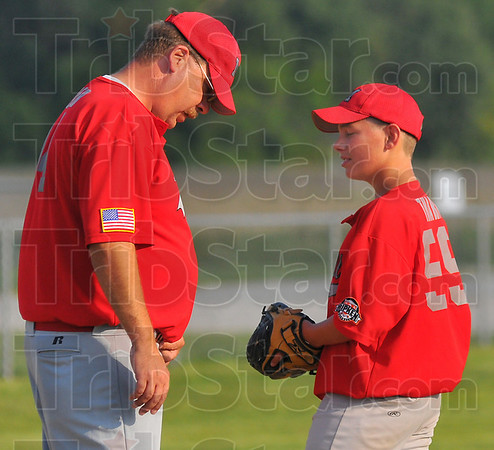 Just keep throwing: Marshall coach Kent Miller talks with his pitcher Zack Tharp during their game with Lexington South at the Cal Ripken tourney Friday evening at the Riley ball diamonds.