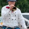 Tribune-Star/Joseph C. Garza<br /> Wheelman Alexander Pollock of Detroit, Michigan, plays his wheelman's cornet during a demonstration Friday at St. Mary-of-the-Woods.