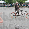 Tribune-Star/Joseph C. Garza<br /> 42nd annual Wheelman meet organizer Steve Carter rides a Schluer tandem bicycle during a demonstration Friday as a youngster takes a photo Friday at St. Mary-of-the-Woods.